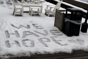 """Family House guests spell out """"We Have Hope"""" in the snow"""